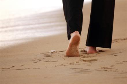 Woman walking on sandbeach in the caribbean